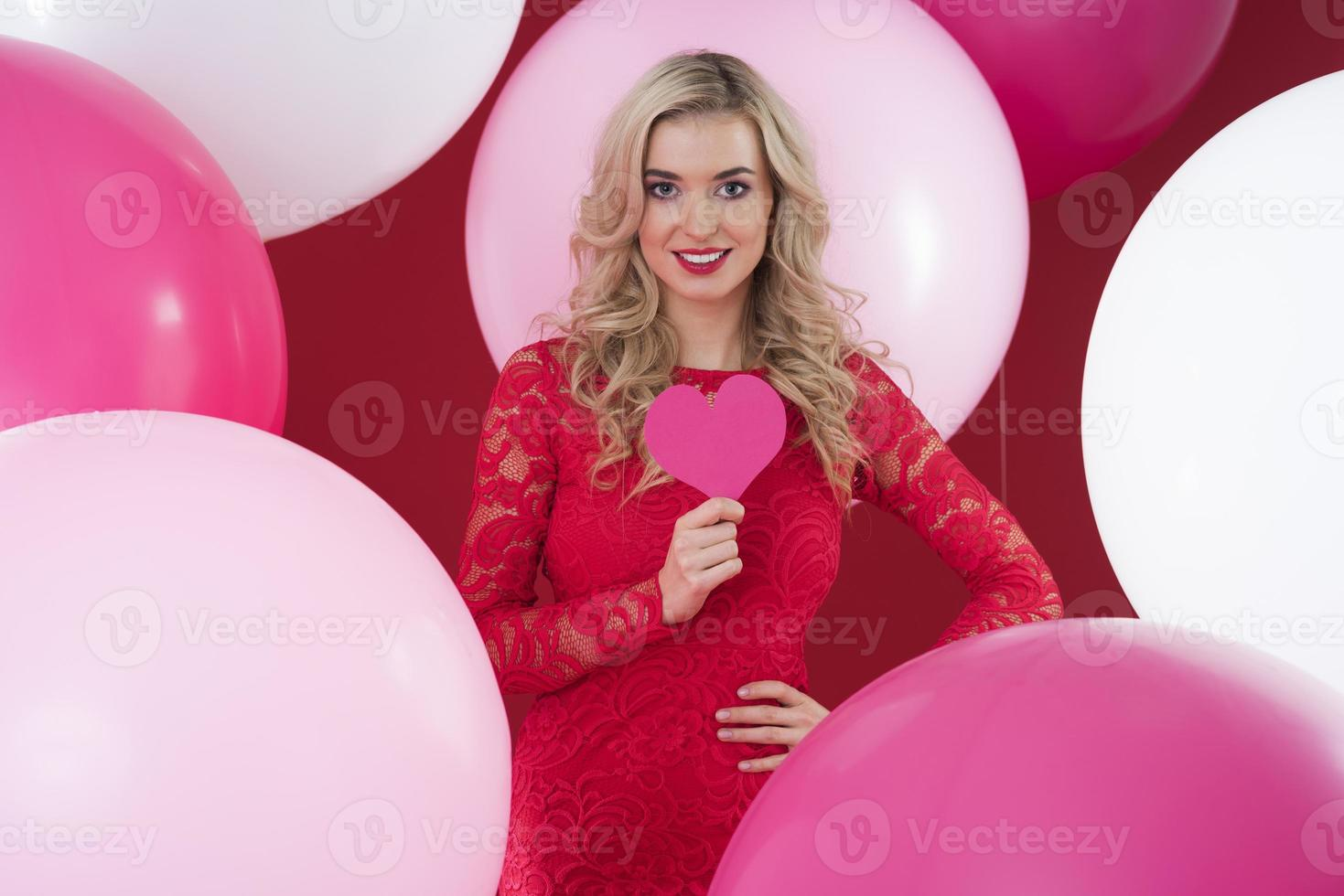 Attractive woman and abundance of balloons photo