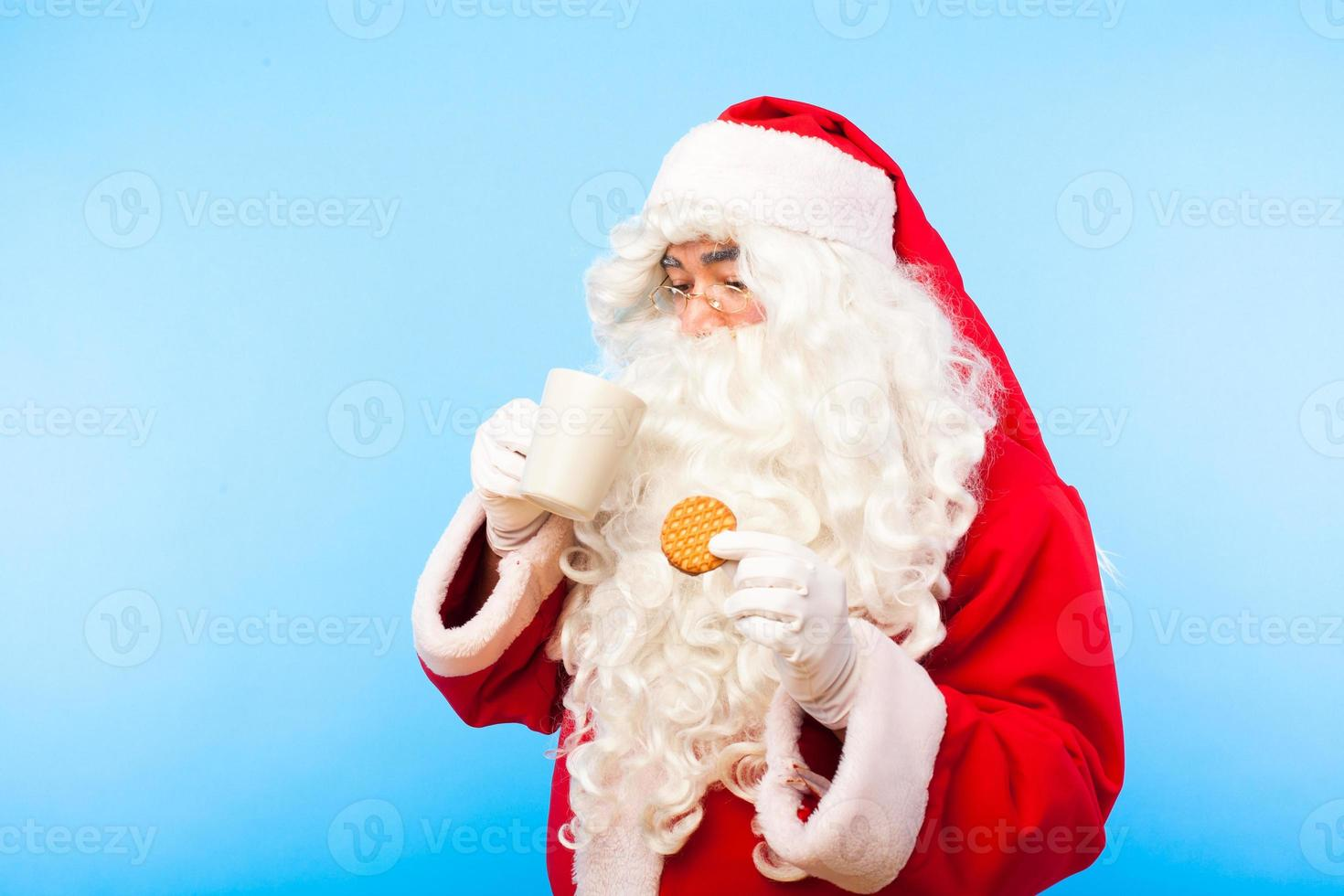 Santa Claus with gifts isolated on white photo