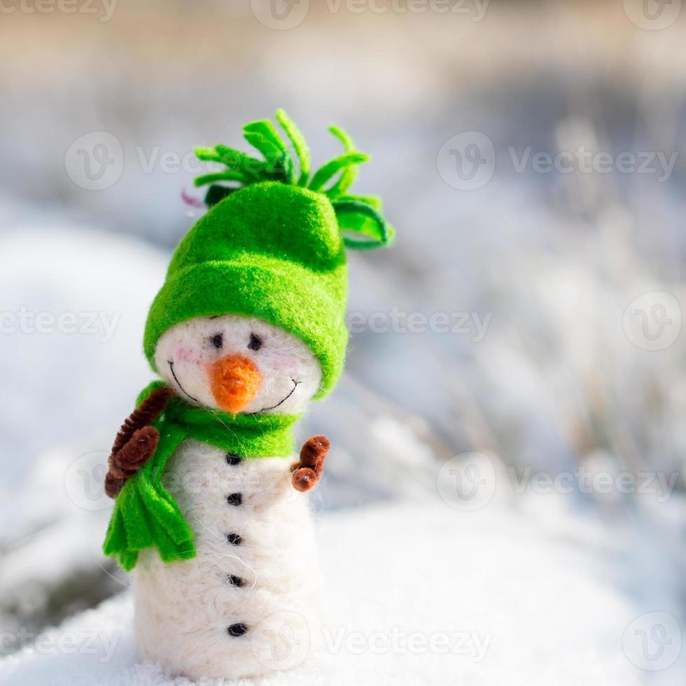 happy snowman on snow photo