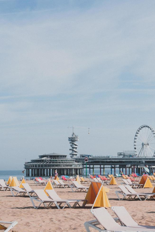 Ferris wheel near body of water during daytime photo