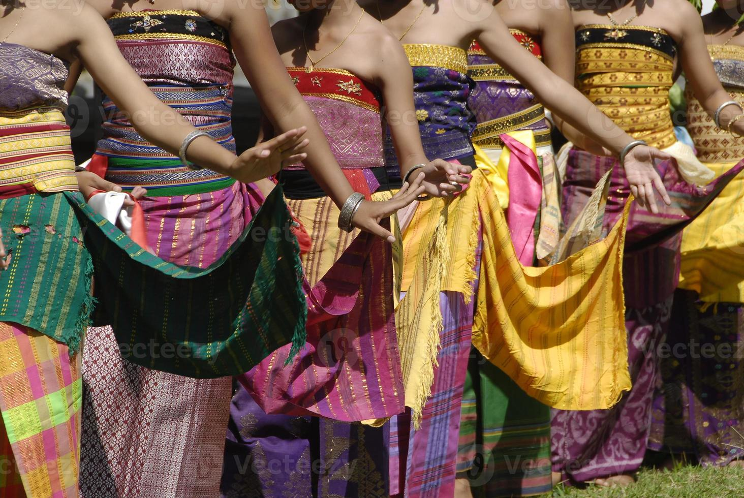 Colourful Balinese Rejang dancers in traditional village ceremony photo
