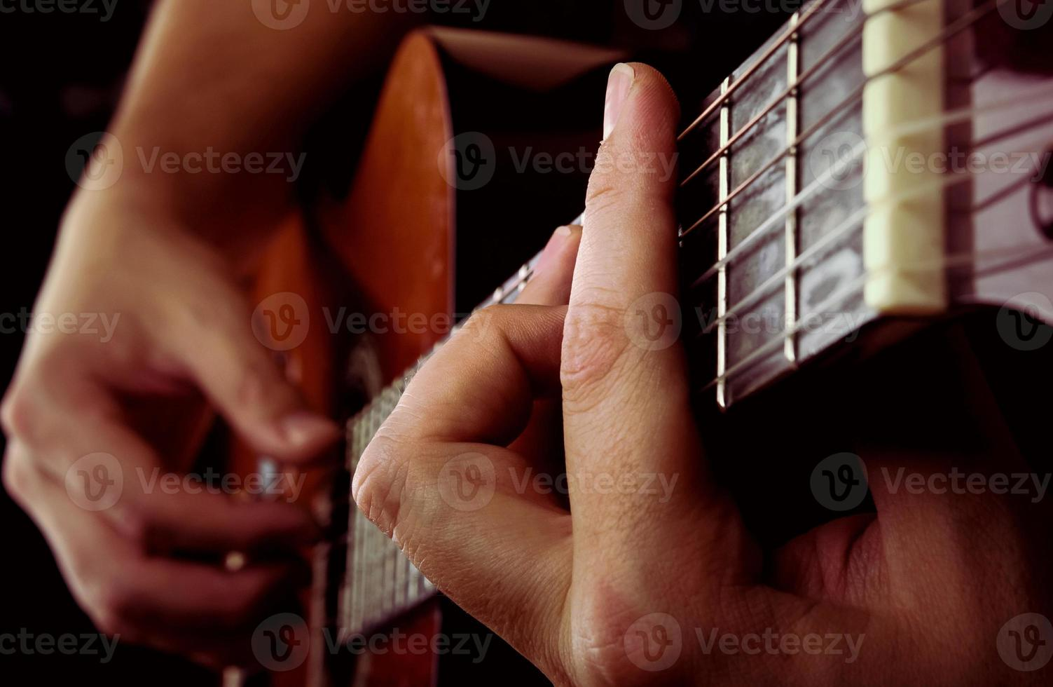 man playing acoustic guitar photo