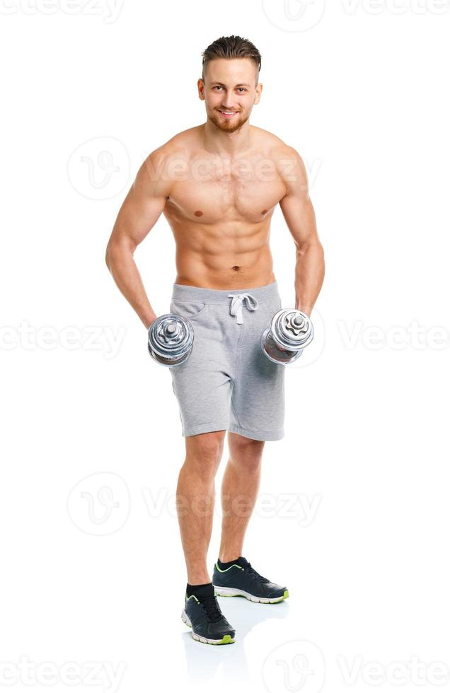 Athletic man with dumbbells on the white photo