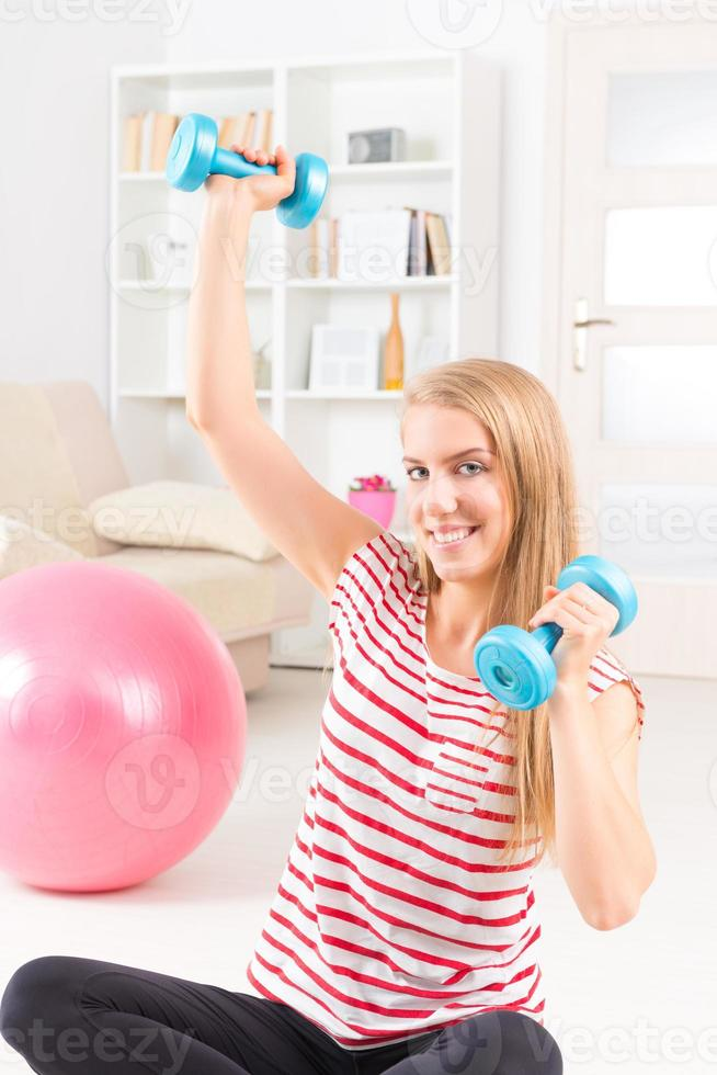 Woman with gym ball photo