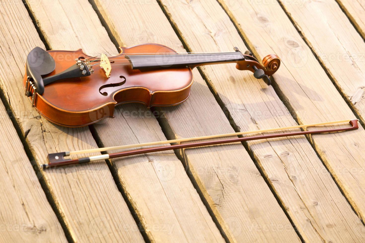Violin on wooden pier. Music concept photo