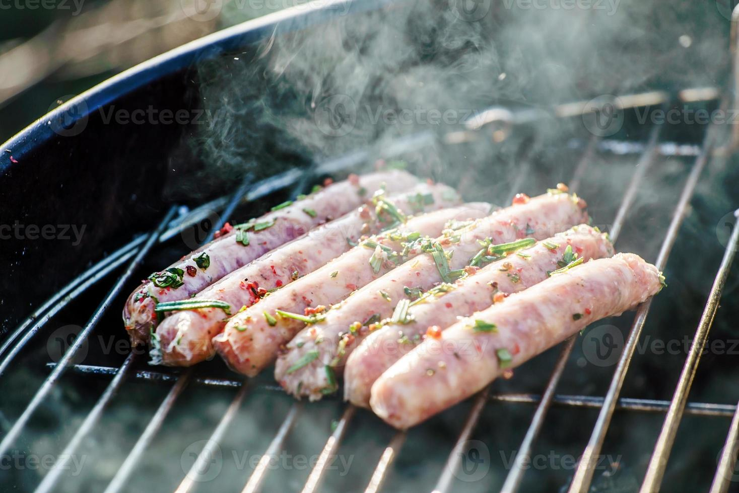 grilling sausages photo