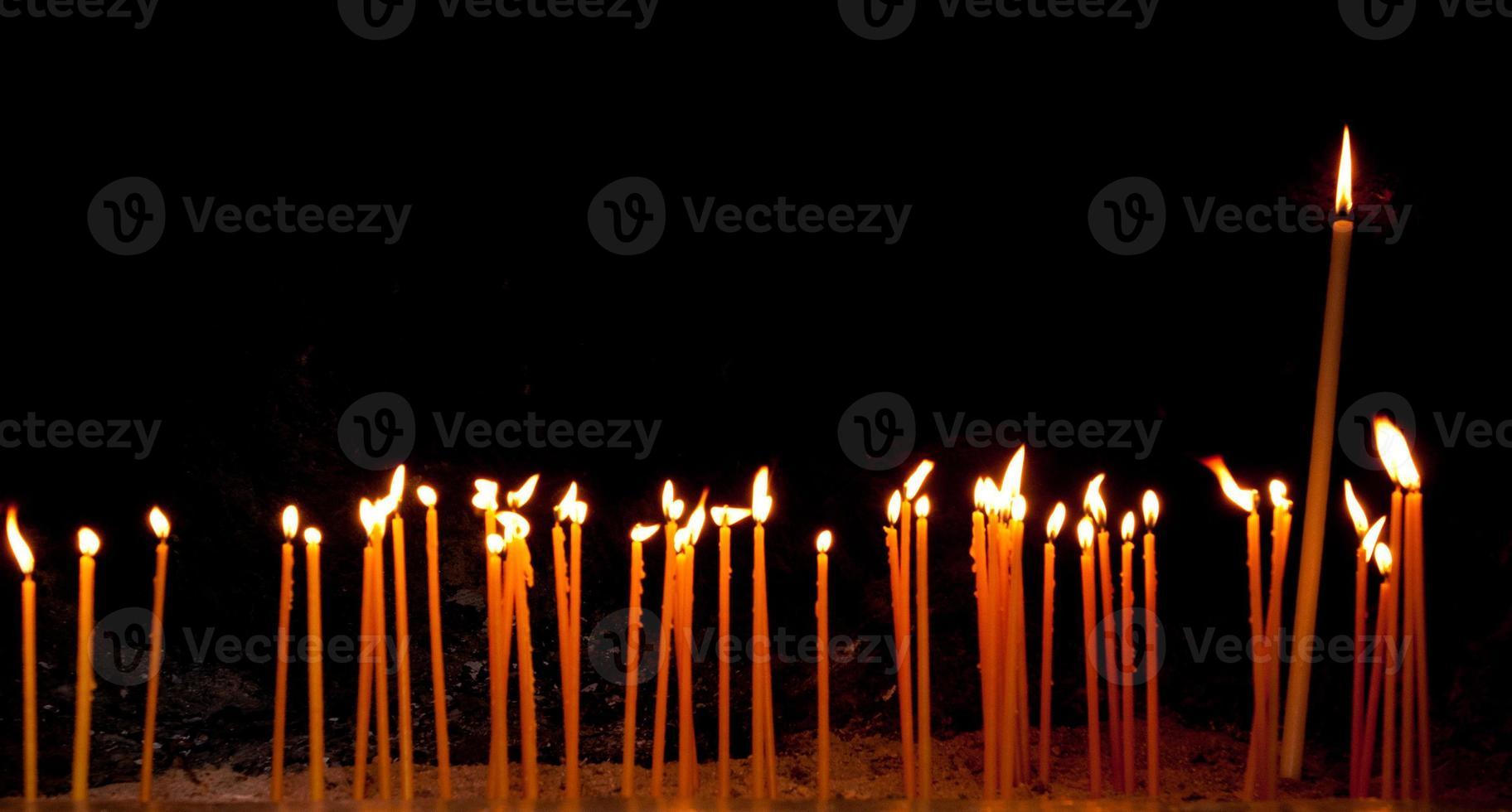 Burning religious candles photo