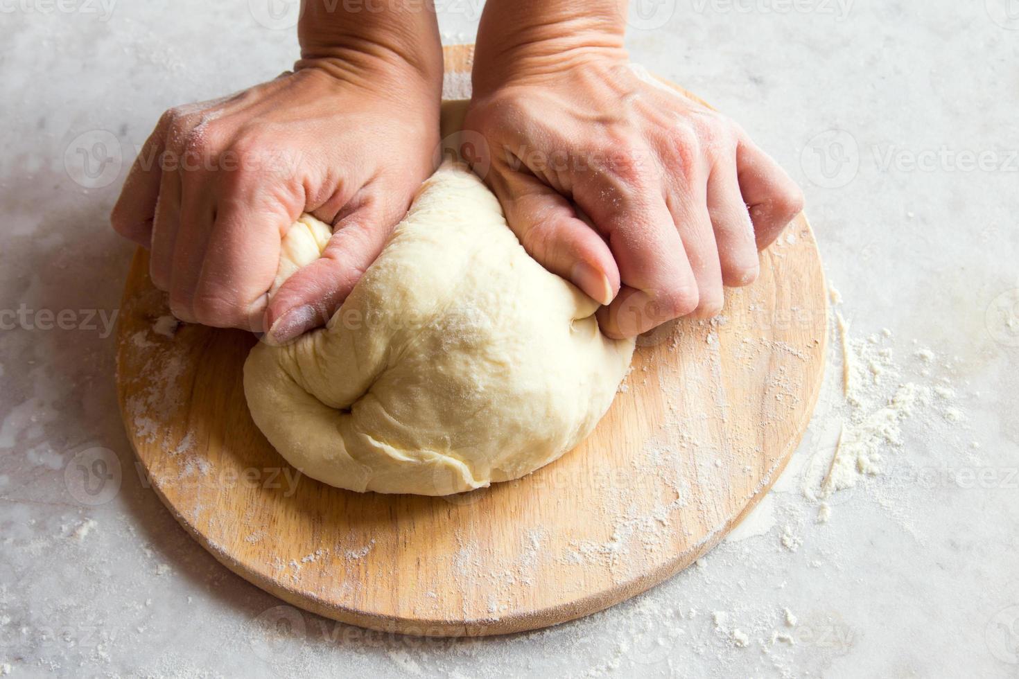 Hands knead dough photo