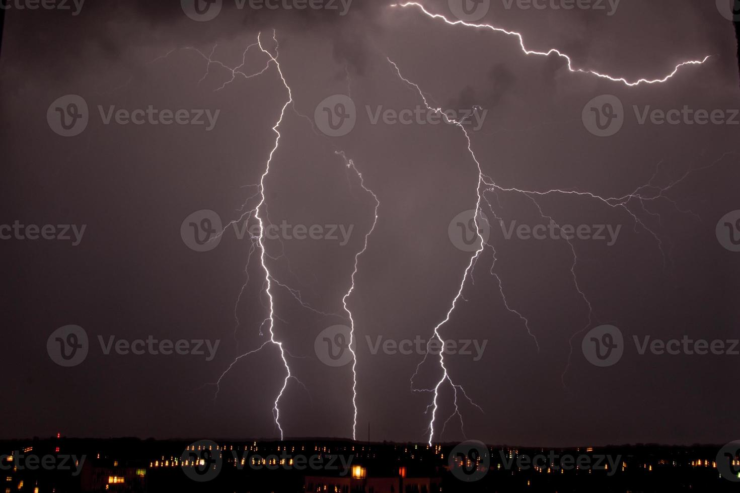 lightning storm over city photo