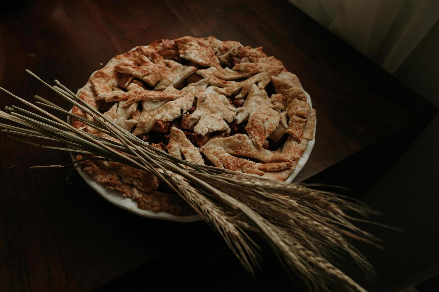 Baked pie on wooden table photo