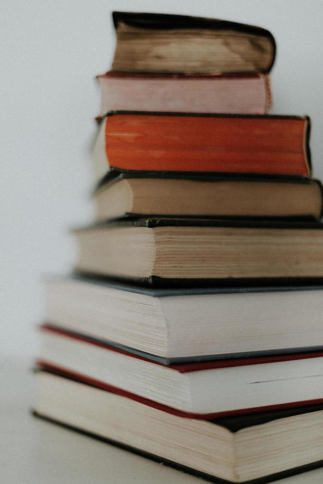 Stack of books on white table photo
