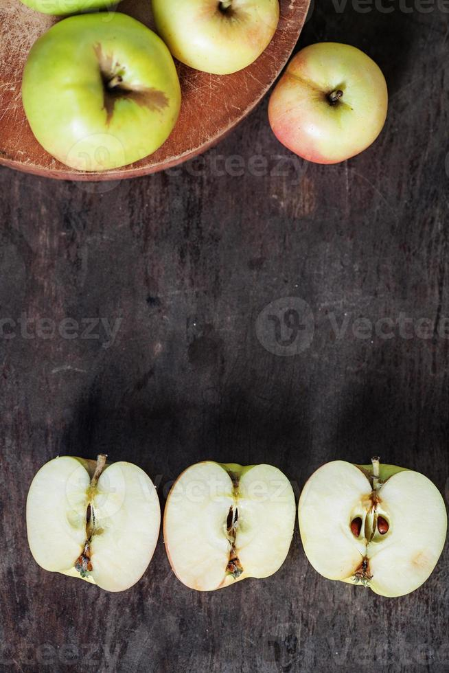 Apples and halves of apples on table photo