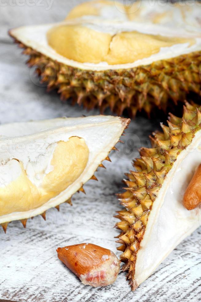 Durian cloves with yellow ripe pulp on table photo