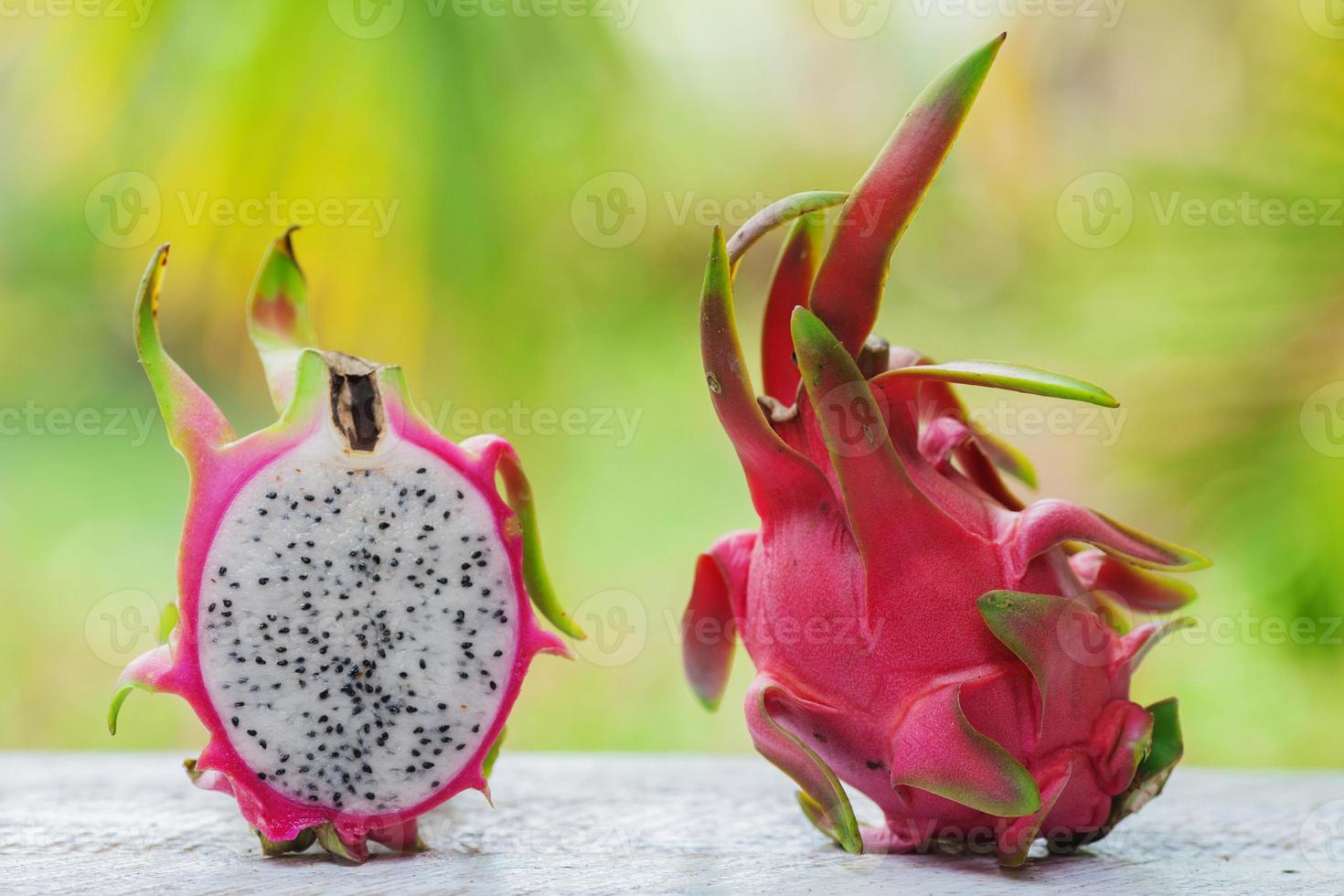 One and a half of pitaya fruit  on table photo
