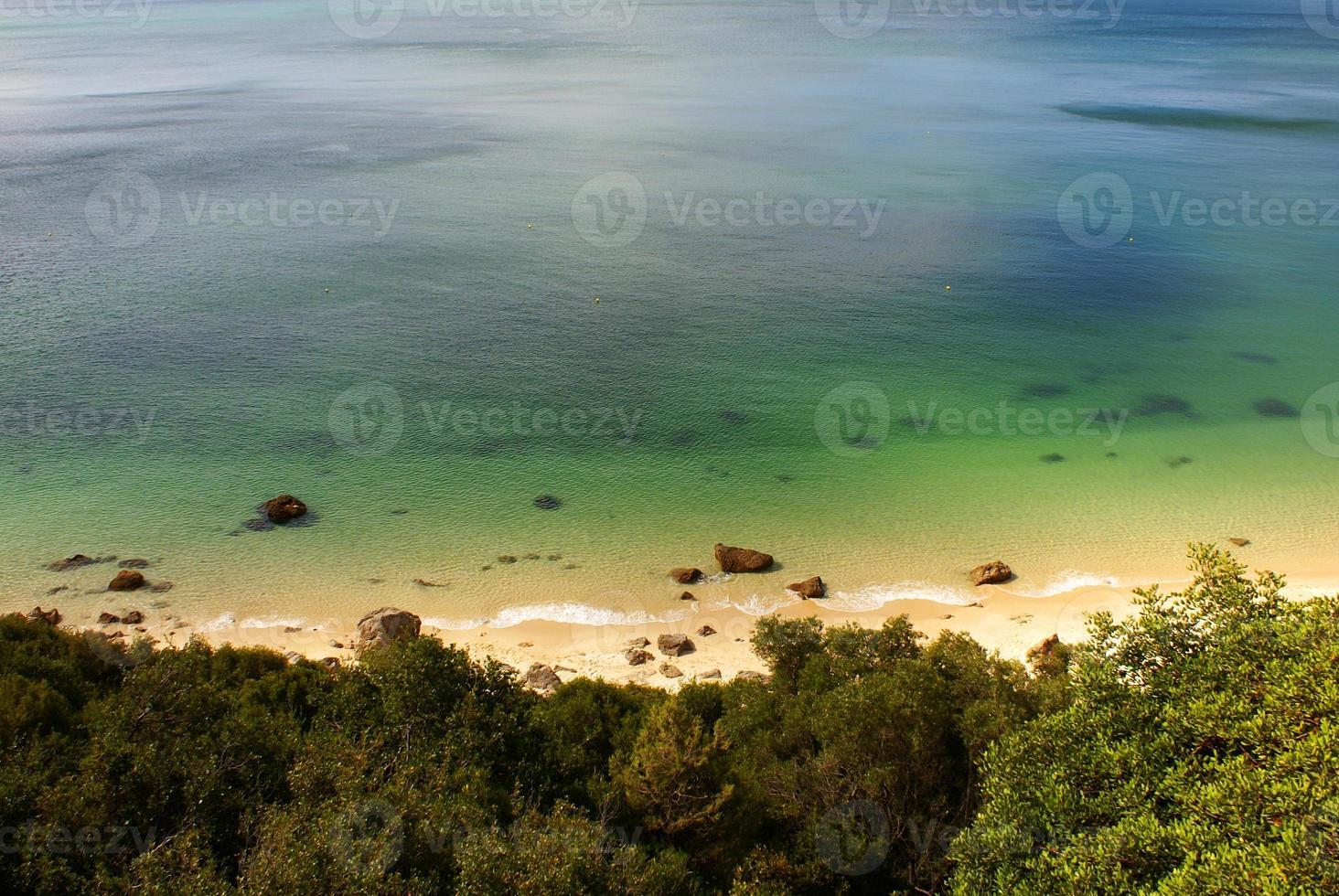 beach bay in Portinho da Arrabida, Portugal photo