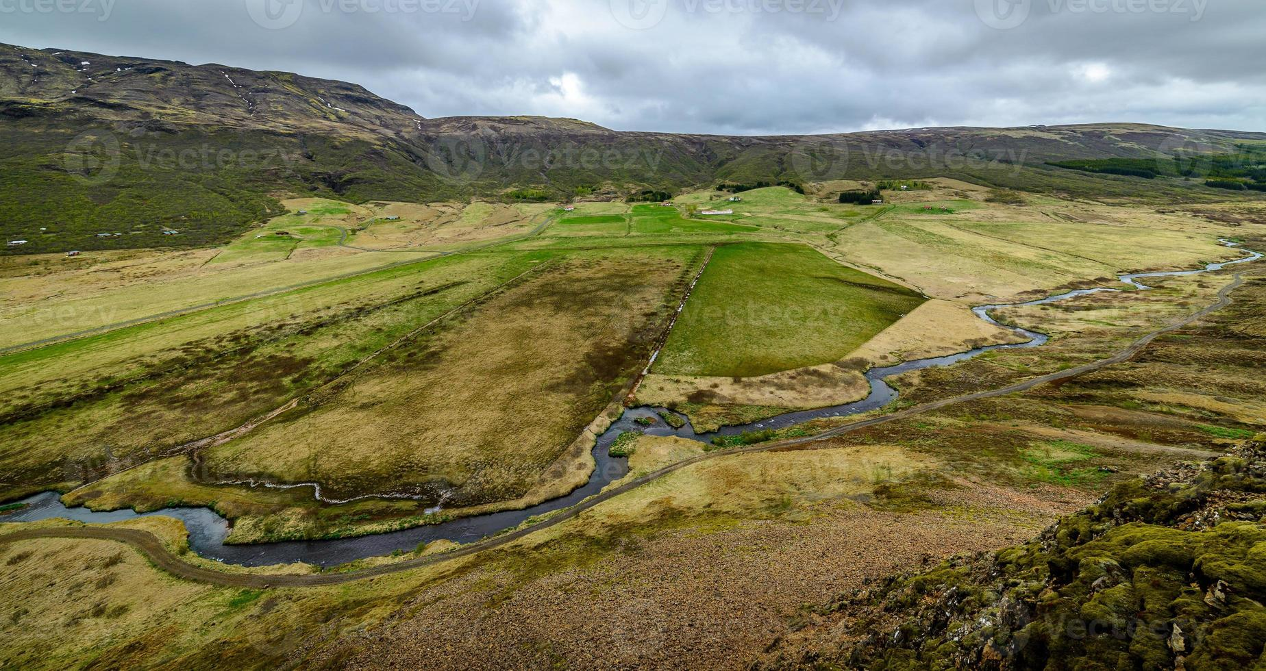 View of an Icelandic valley from a mountain above photo