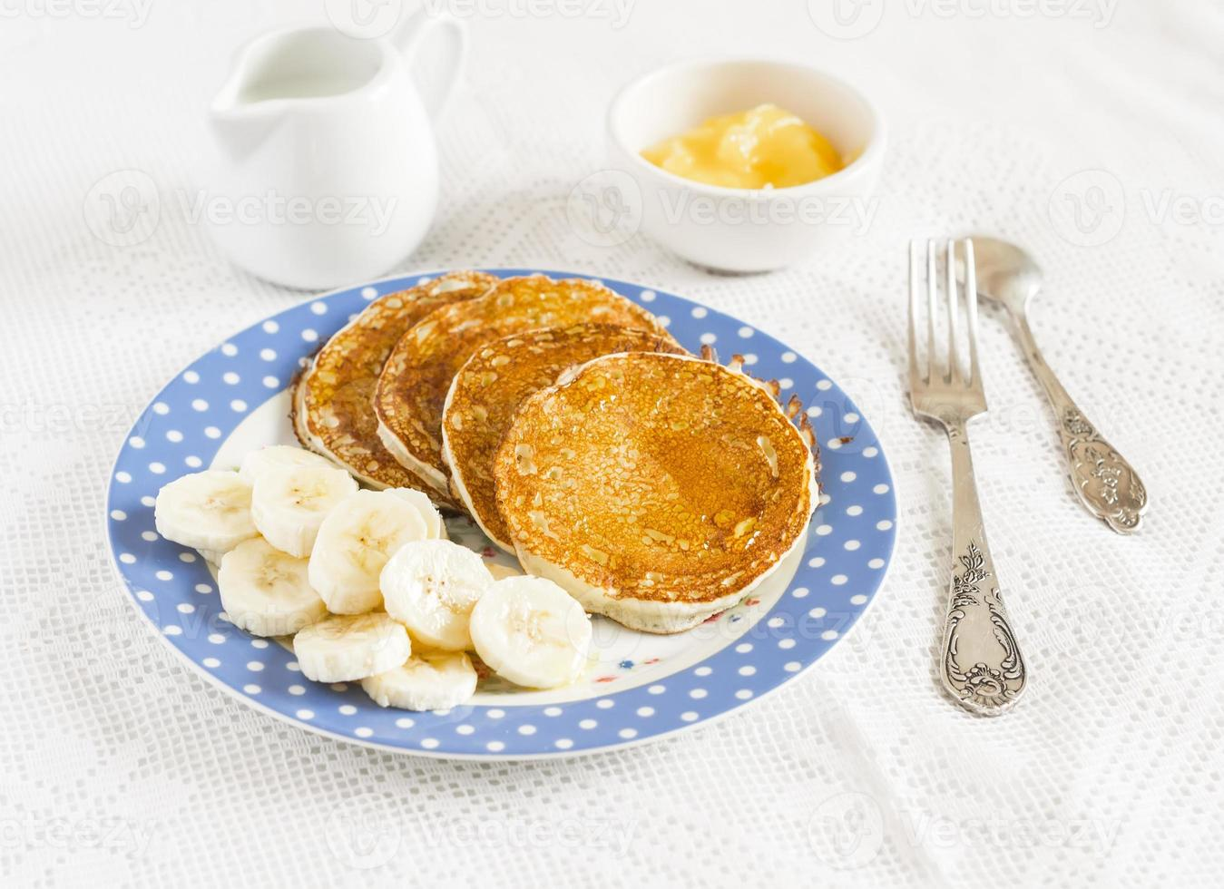 Banana pancake. Delicious breakfast. On a light surface photo