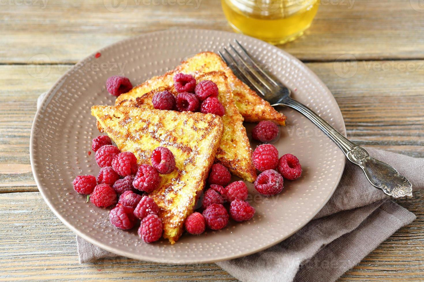 Tasty French toast with fresh raspberries photo