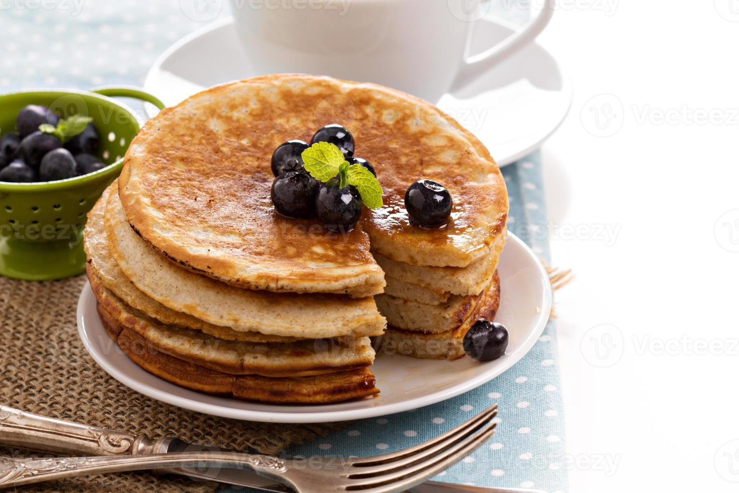 Stacked pancakes with berries photo