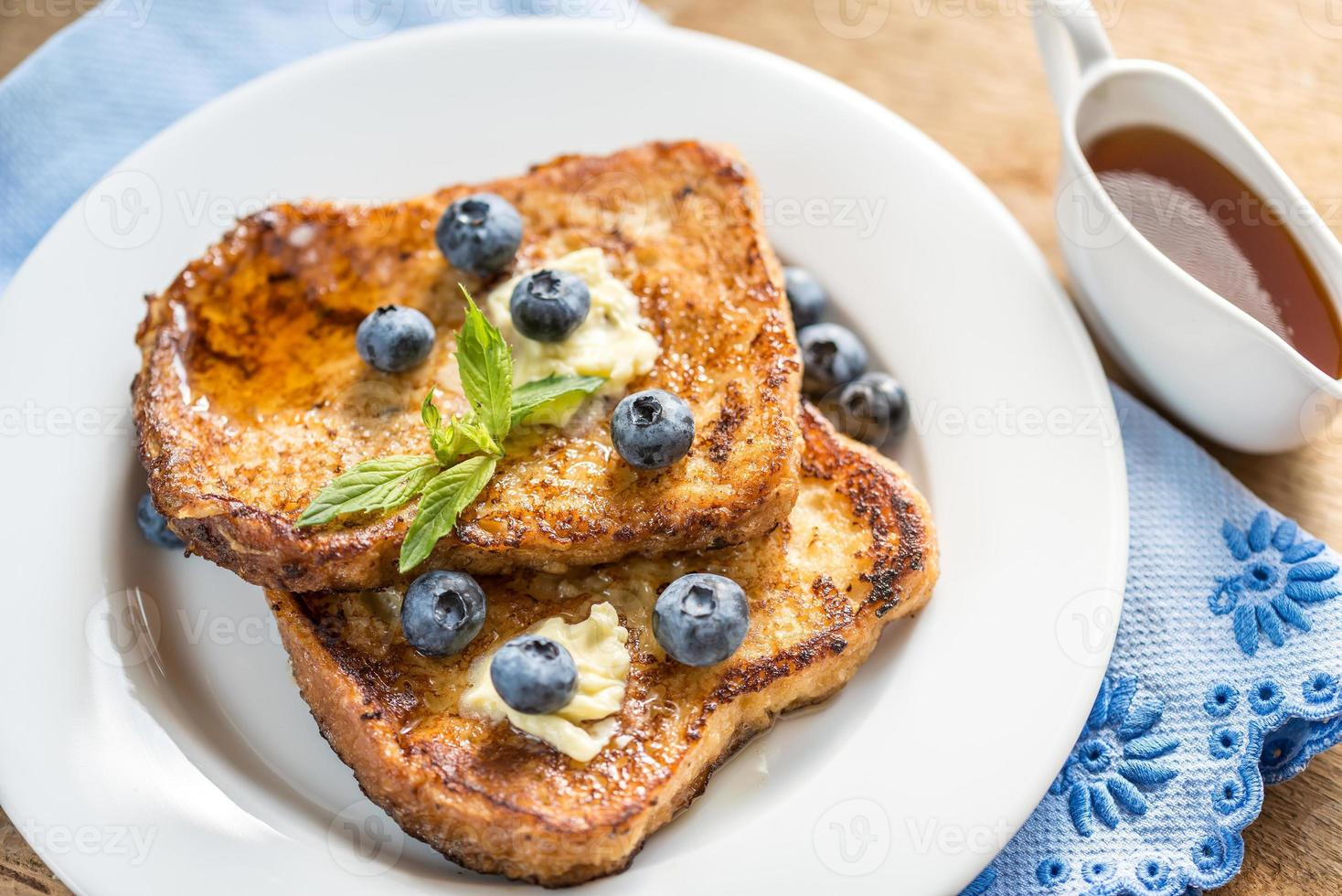 French toasts with fresh blueberries and maple syrup photo