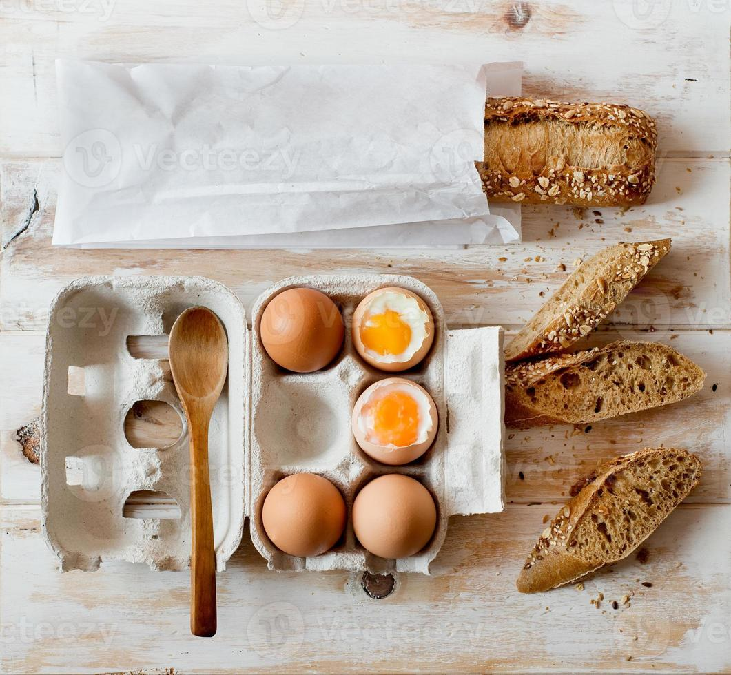 Soft boiled eggs and wholemeal bread. photo