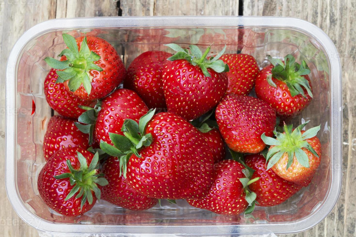 punnet of frshly icked strawberries photo