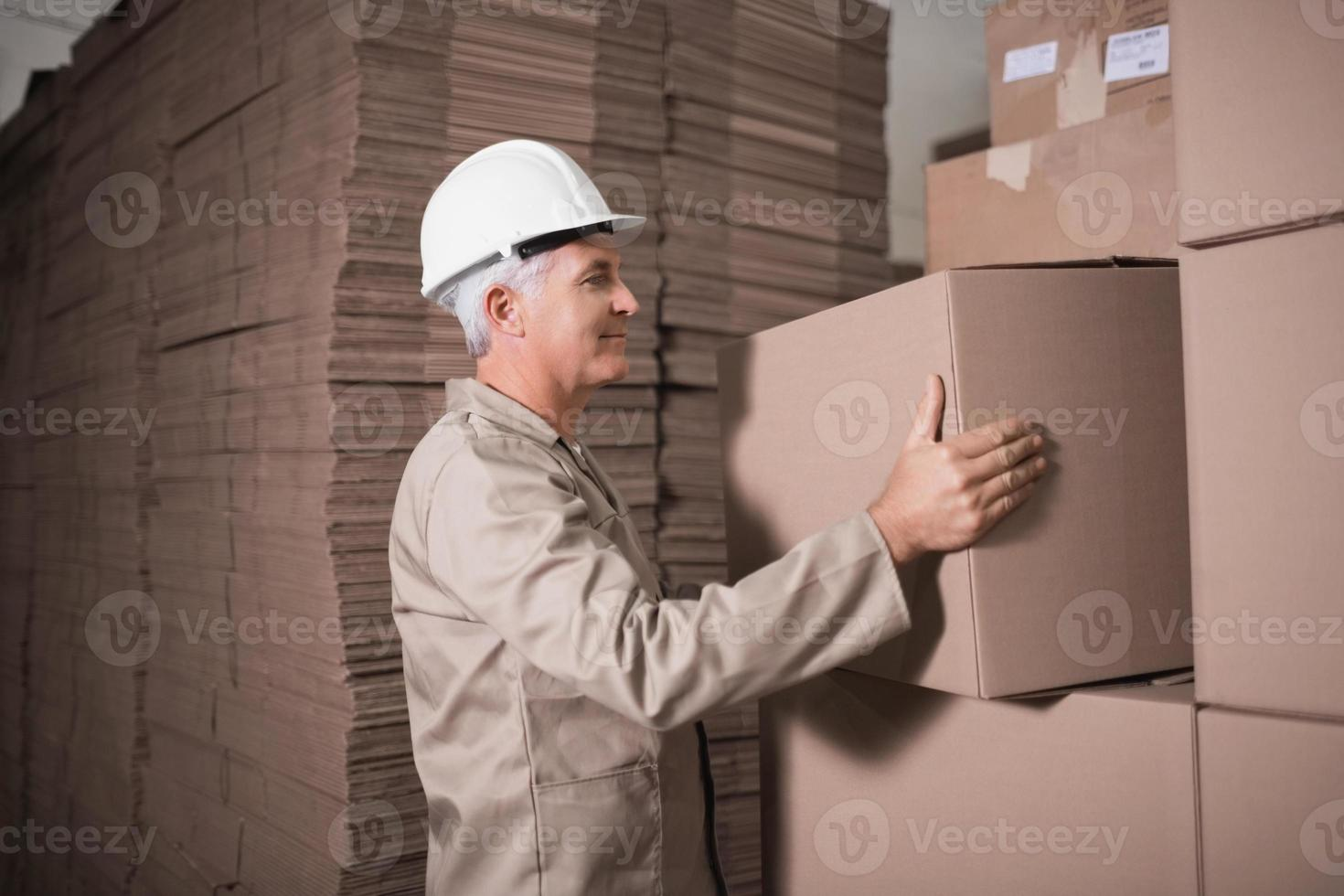 Warehouse worker loading up pallet photo