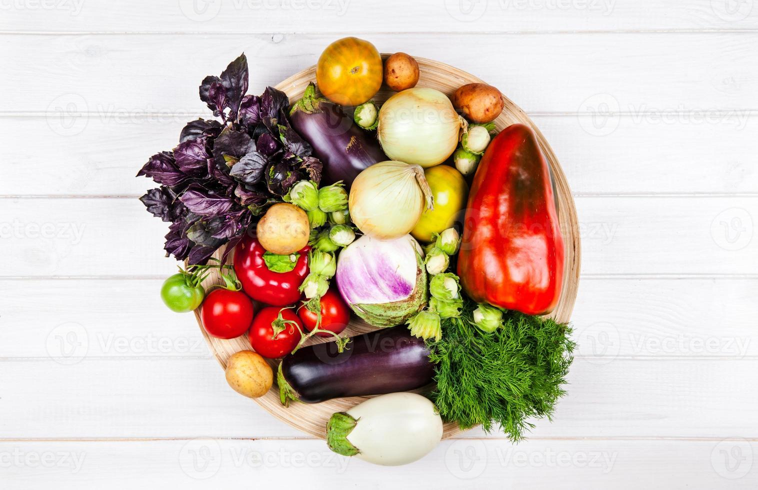 fresh vegetables on white wooden background photo