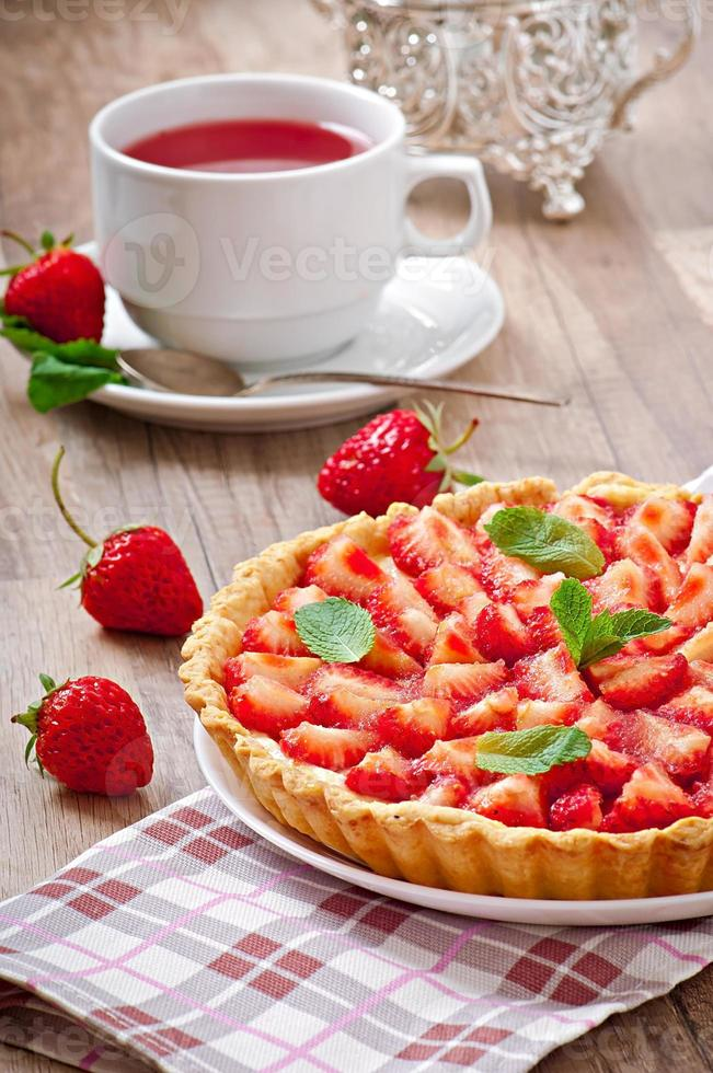 Strawberry tart with custard photo