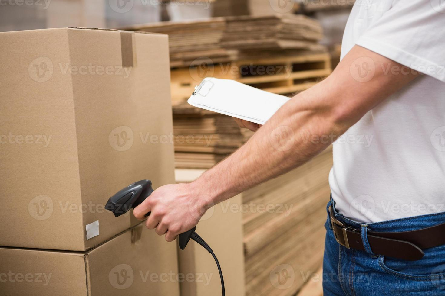 Worker using scanner in warehouse photo