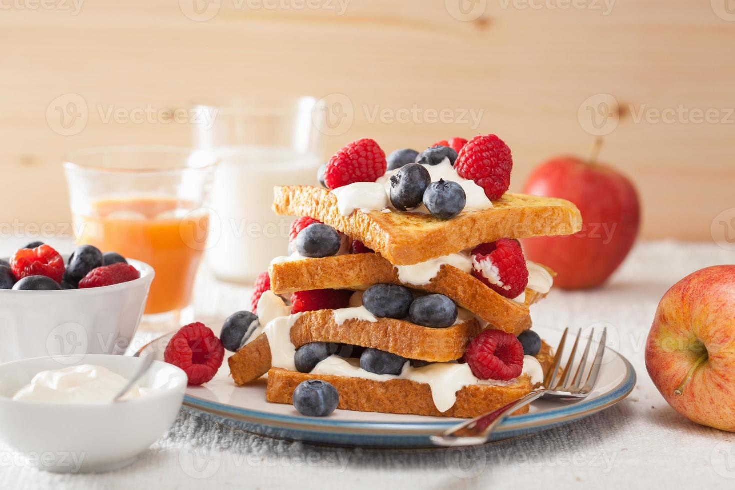 french toasts with creme fraiche and berries for breakfast photo