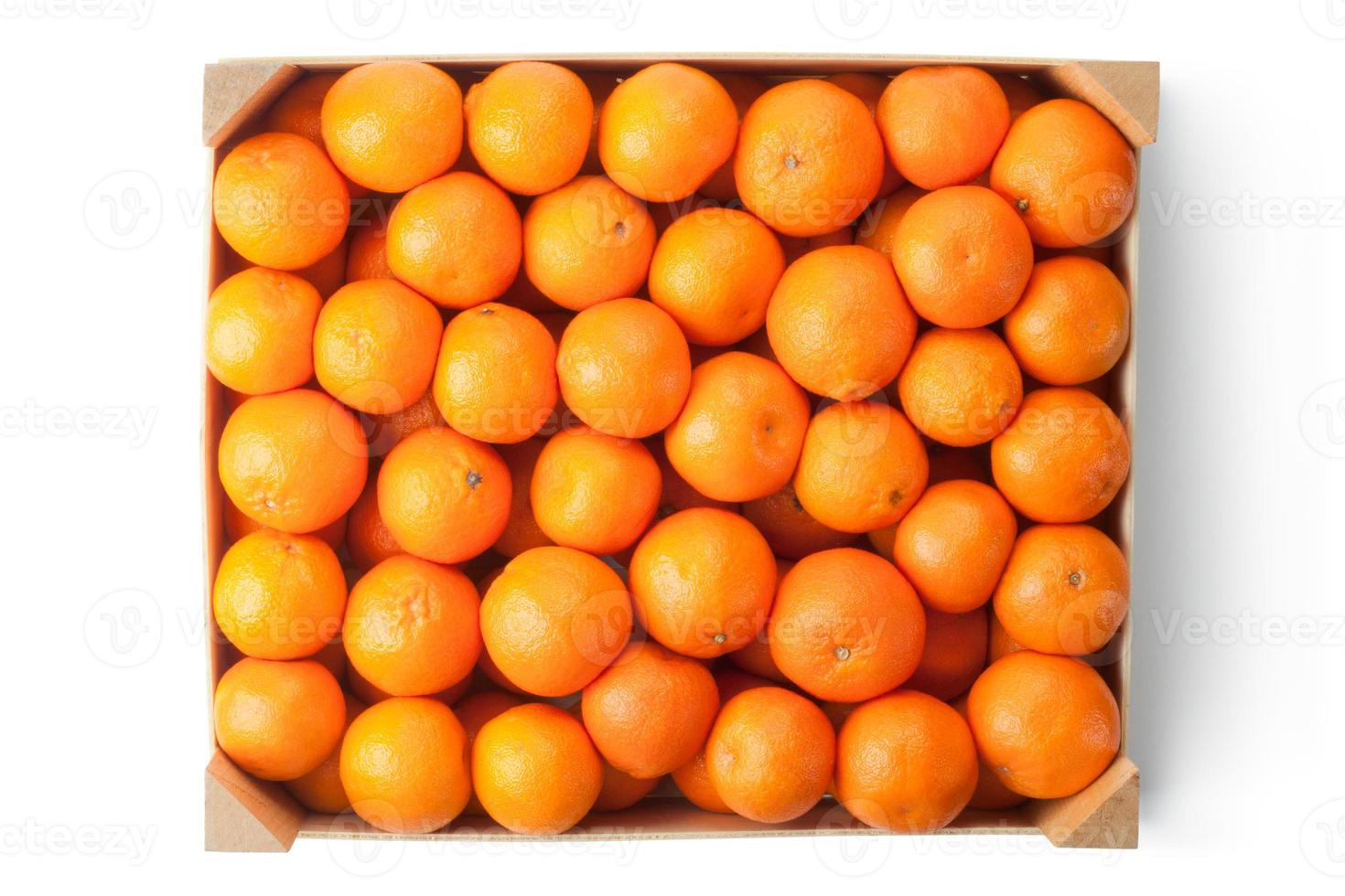 Crate of ripe tangerines. Top view. photo