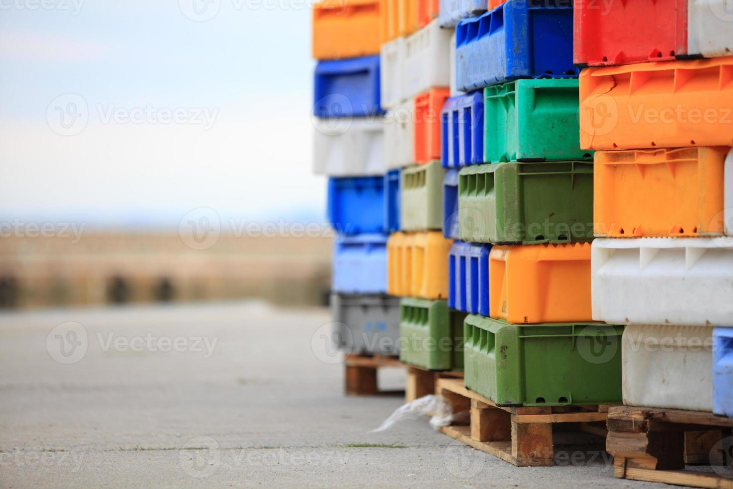 colorful boxes plastic crates containers for fish photo