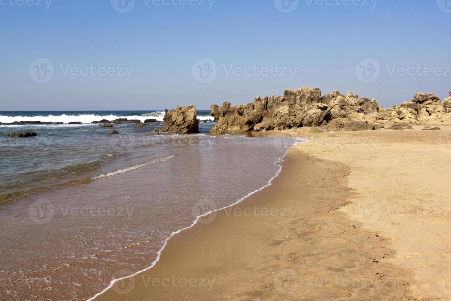 Rough Rock Formation at Umdloti Beach, Durban South Africa photo