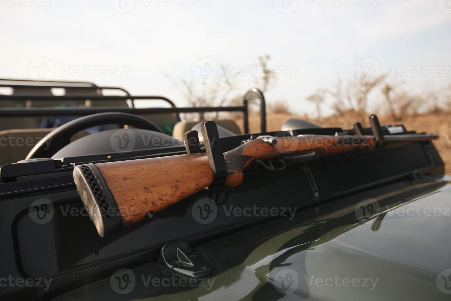 Rifle On Hood Of Safari Vehicle photo