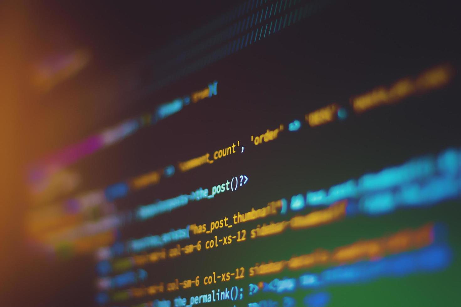 Shallow focus of code on a computer screen photo
