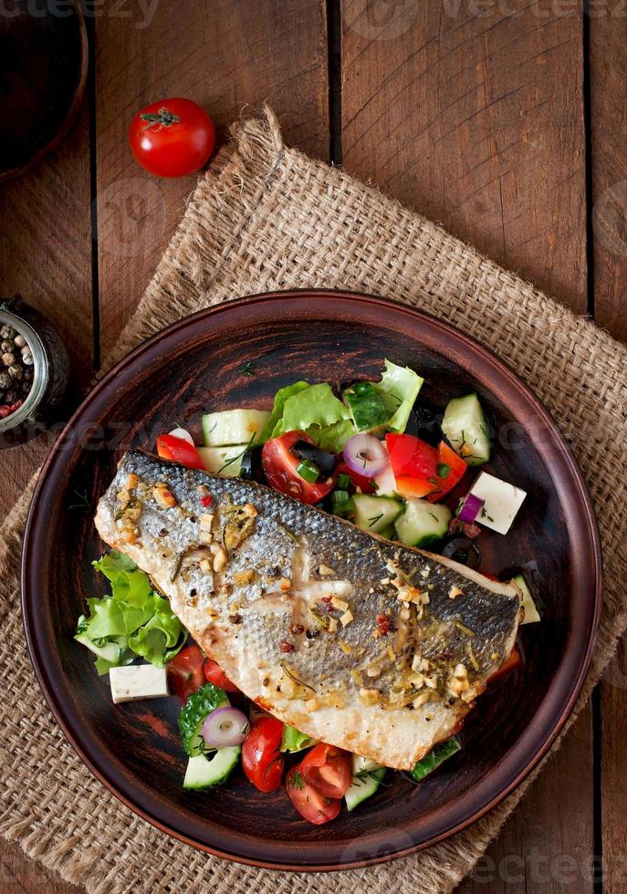 Baked seabass with Greek salad photo