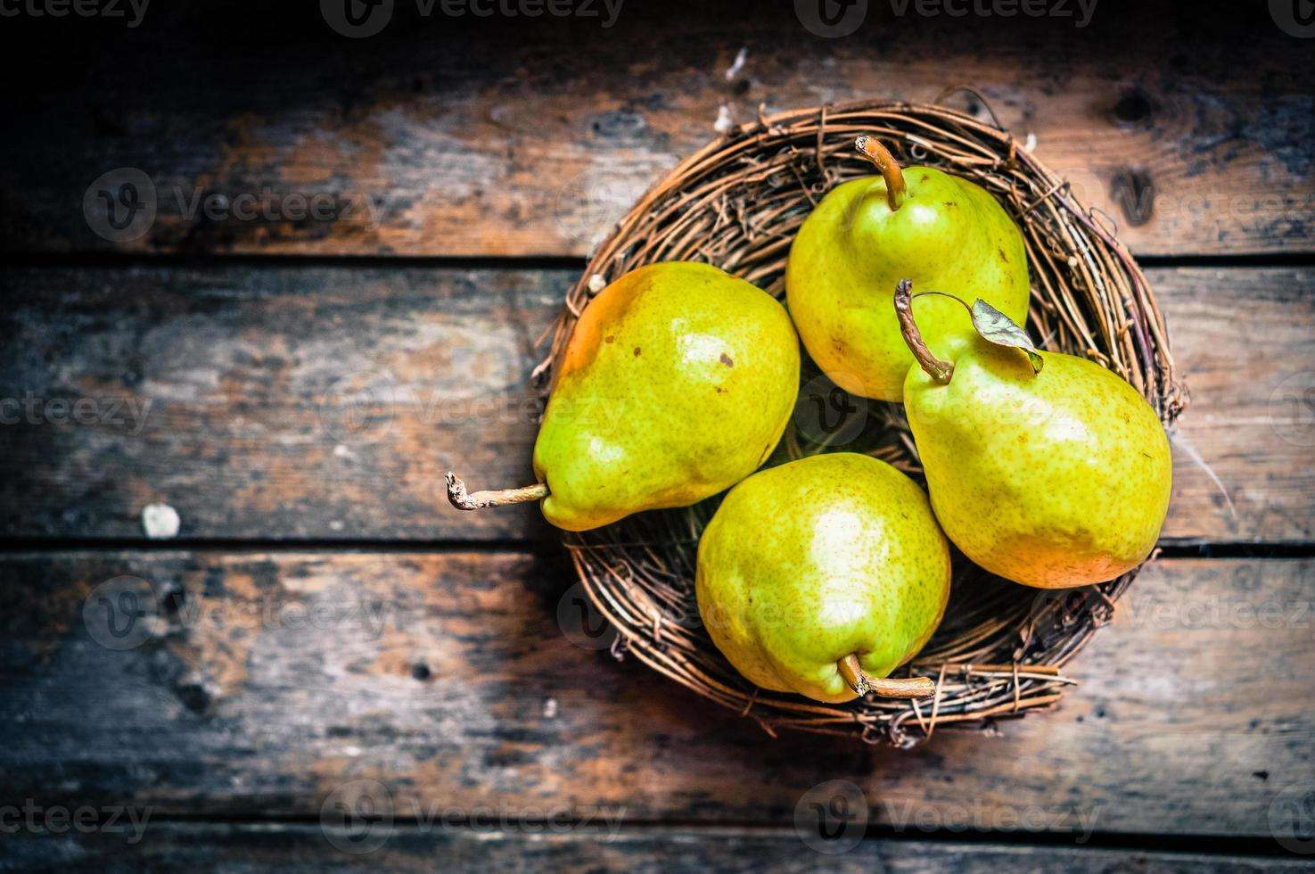 Pears on rustic wooden background photo