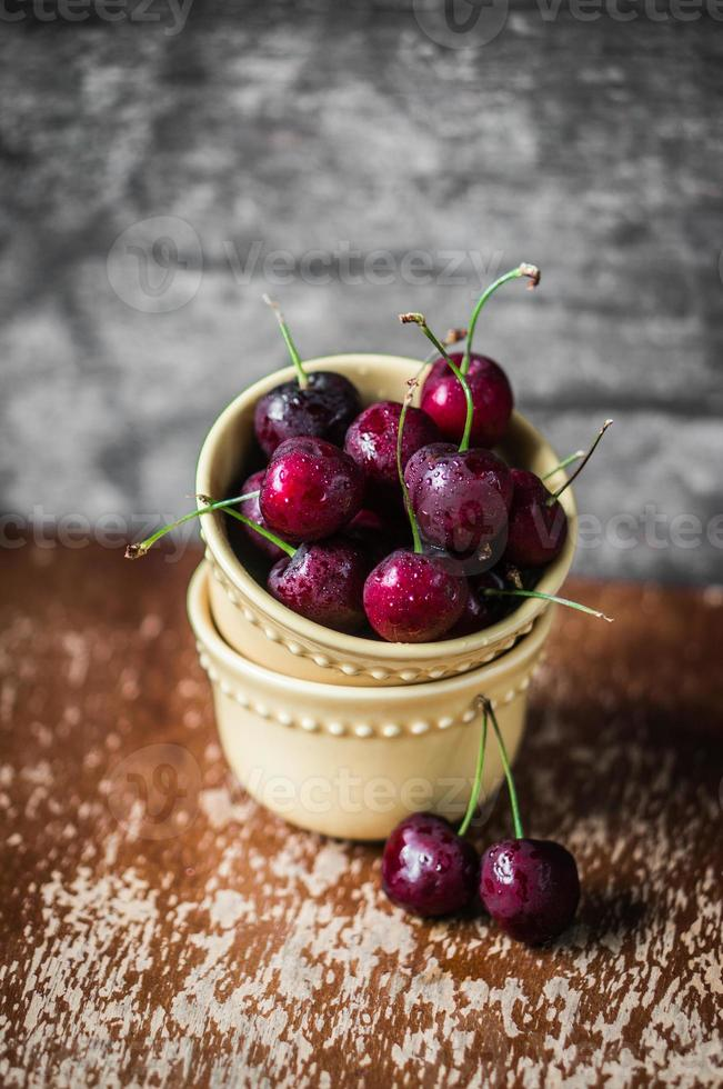Cherries on rustic wooden background photo
