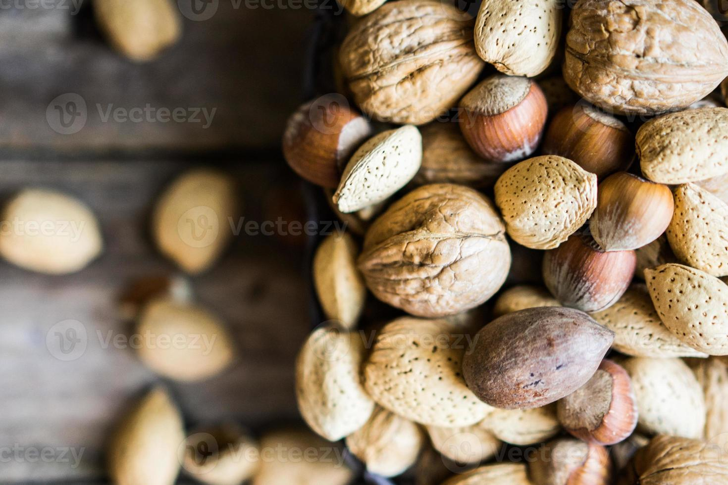 Nut mix on rustic wooden background photo