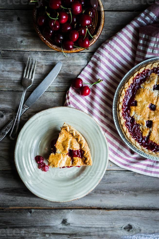 Homemade cherry pie on rustic background photo