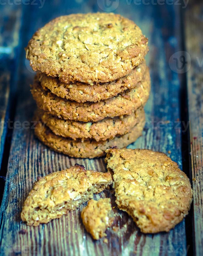 Vintage oatmeal cookies on rustic wooden background photo