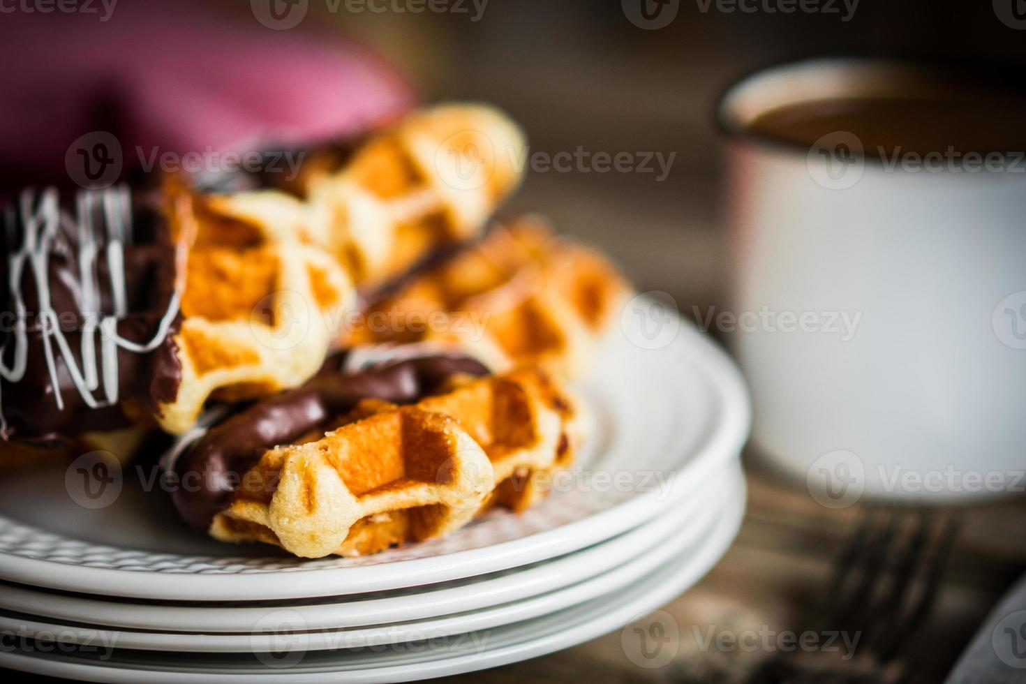 Belgian waffles with chocolate on rustic wooden background photo