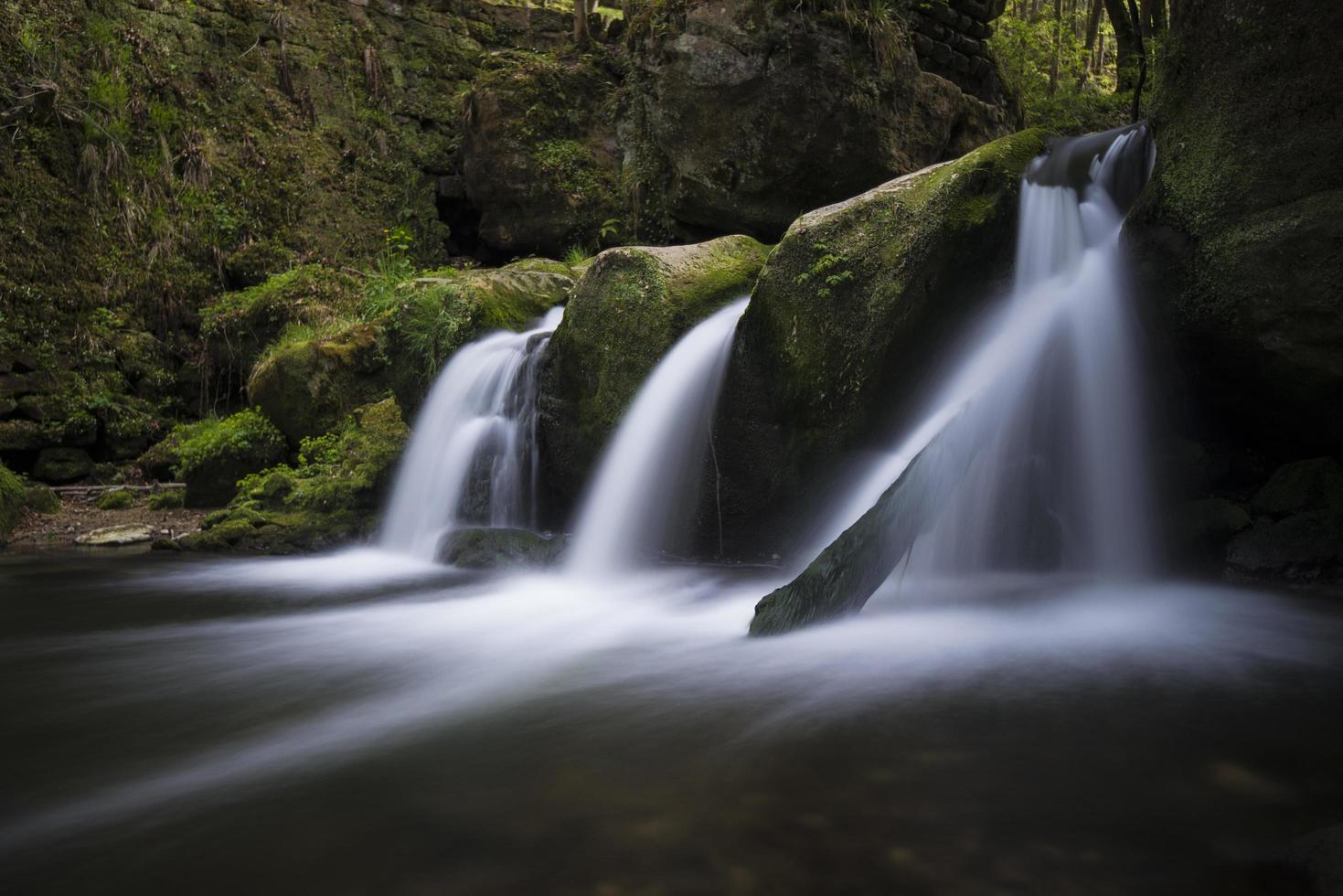 Flowing waterfall in Luxembourg photo