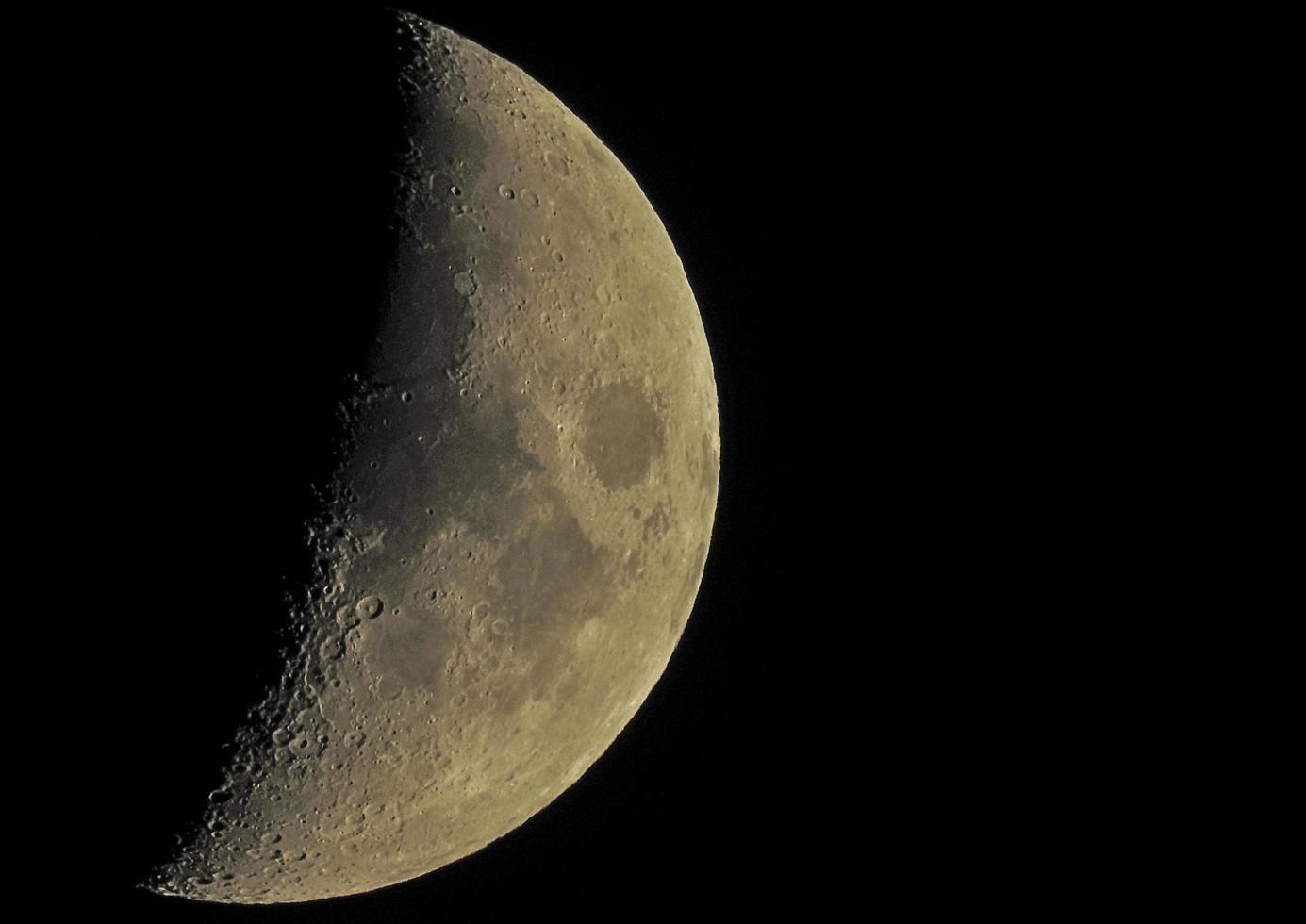 Half moon on black sky photo