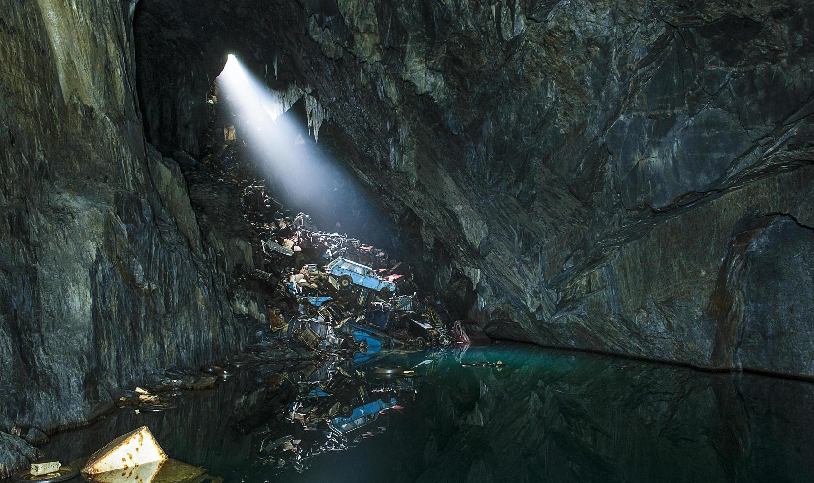 Light shining through a cave photo