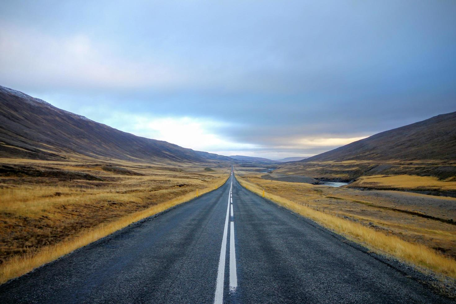 Road running through a hilly landscape photo