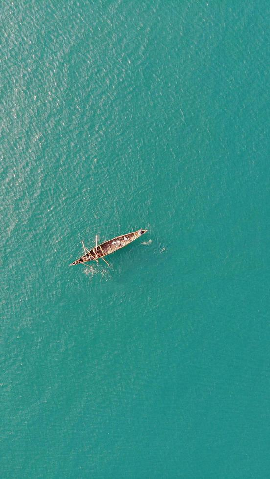 Aerial view of boat on a calm sea photo