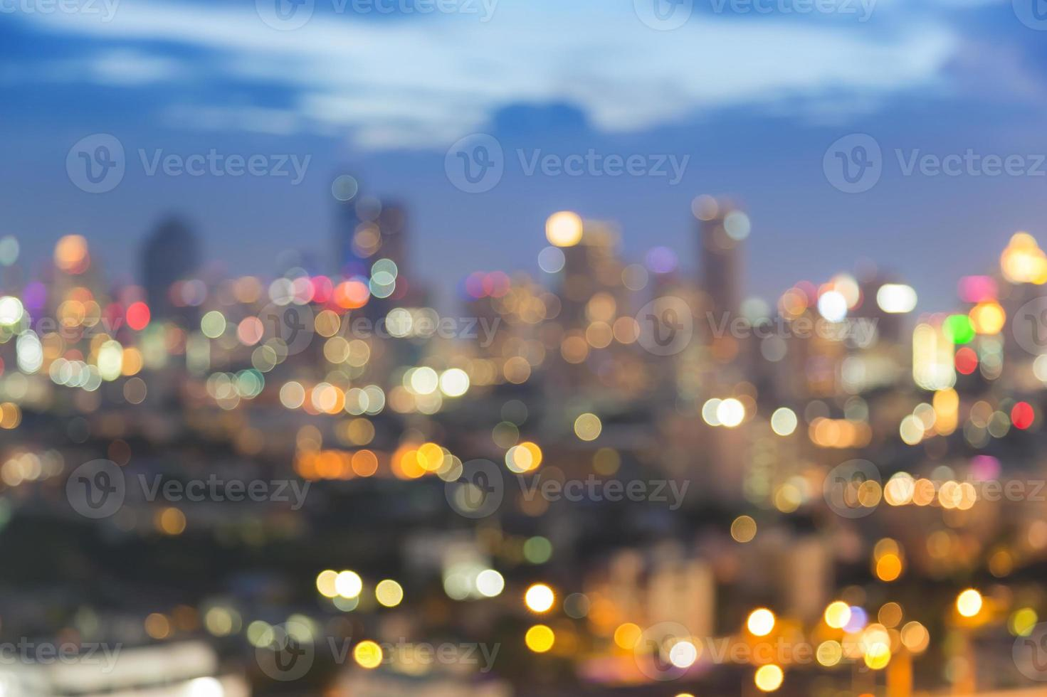 Abstract multiple bokeh city light during twilight photo