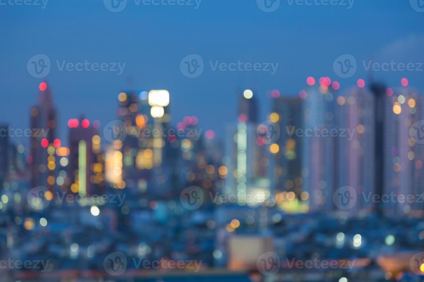Defocused city light skyline at night photo